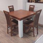 Ciemny stół z białymi nogami i czteroma krzesłami